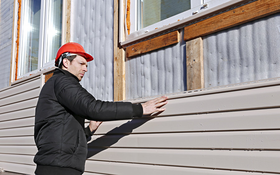 worker working installing siding